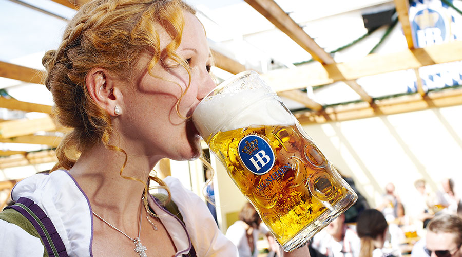 Oktoberfest goer drinks an Oktoberfestbier while inside the tent in Munich, Germany